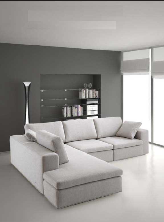 Libreria dietro divano camera studio con divano letto for Divano incassato